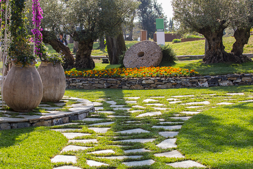 Horizontal Image Of A Beautiful Garden With Stones And Large Vases And Decorative Plants In The Background Stock Photo Download Image Now Istock