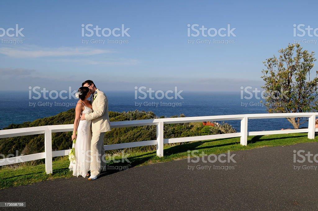 Horizontal image of a newlywed couple kissing royalty-free stock photo