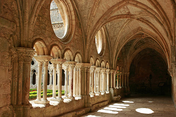 Horizontal image of medieval architecture with no activity Medieval abbey corridor. Copy space. abbey monastery stock pictures, royalty-free photos & images
