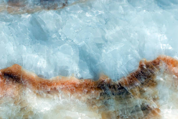 Horizontal lightened slices of blue marble quartz ice background. with brown stripe Cold calm colors icy background ideal for your design Horizontal lightened slices of blue marble quartz ice background. Cold calm colors icy background ideal for your design. Beautiful close up background. Ideal for sites, banners, backgrounds, photo paper wall, brochures, design quartz stock pictures, royalty-free photos & images