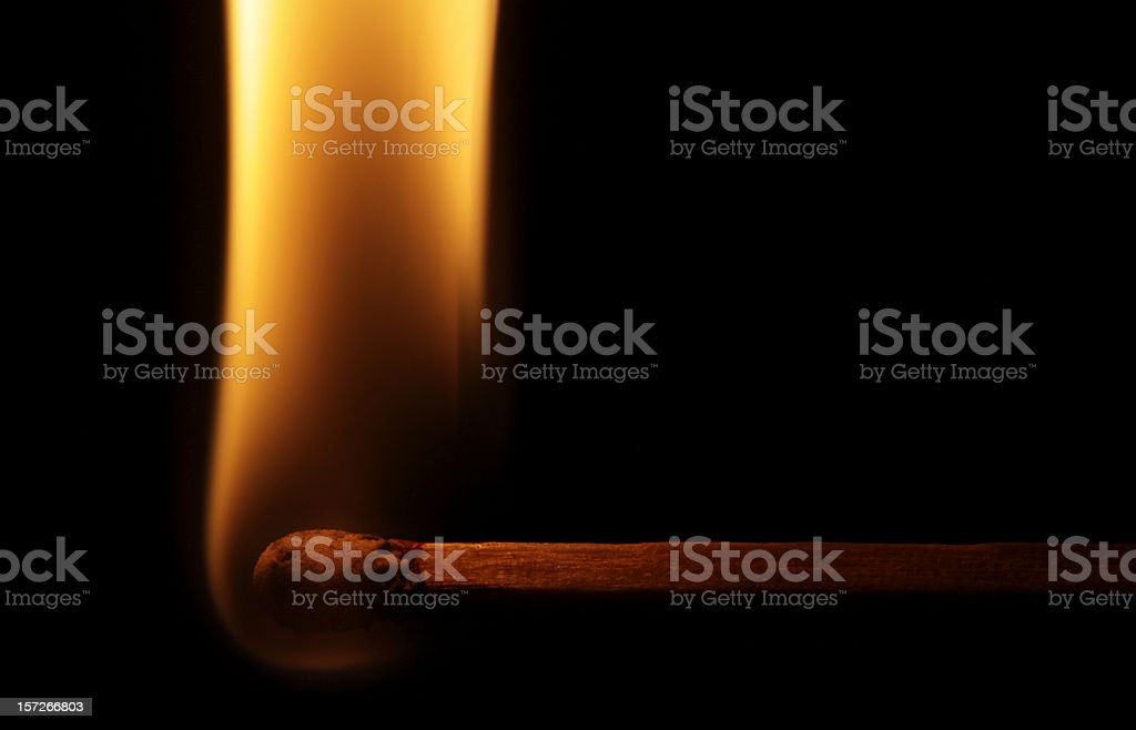 Horizontal match with flame royalty-free stock photo