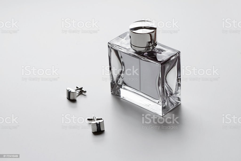 Horizontal mens cologne and cufflinks stock photo