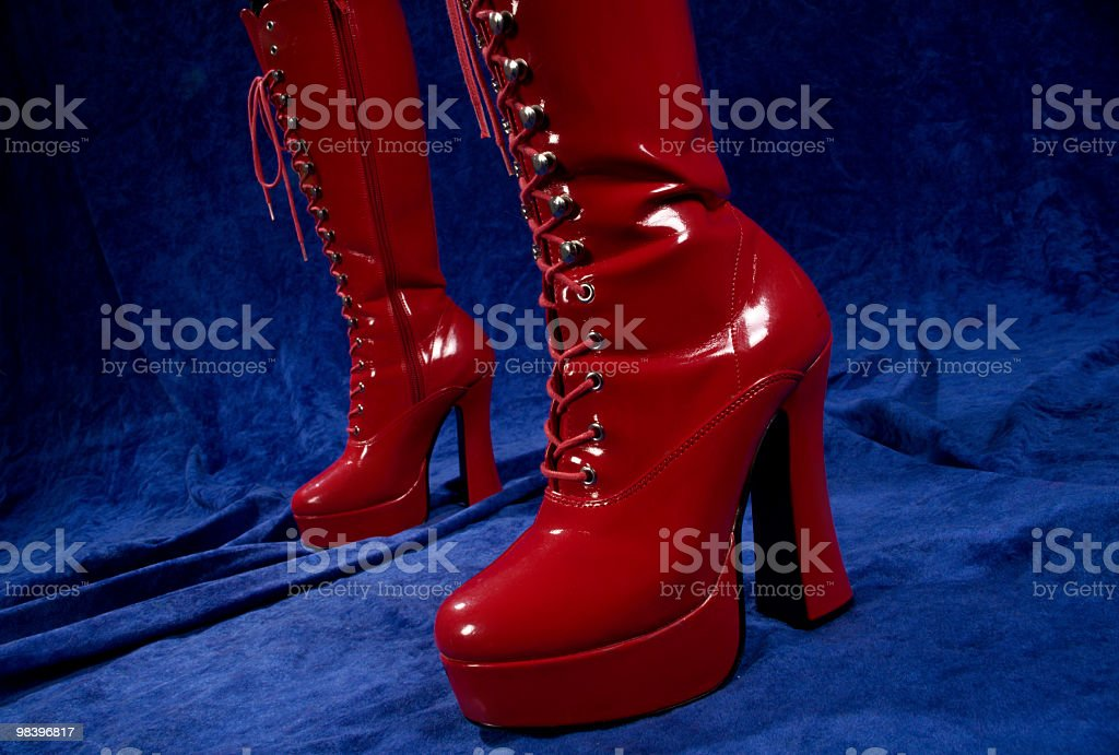 Horizontal of shiny red dominatrix boots. royalty-free stock photo