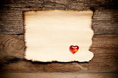 istock Horizontal old paper on wooden background 488518655