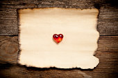 istock Horizontal old paper with glassware red heart 488959475