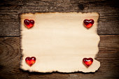 istock Horizontal old paper with glassware red hearts 488959489
