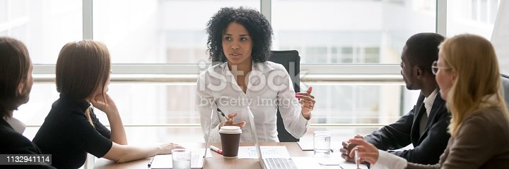 istock Horizontal photo african female boss talking at corporate meeting 1132941114