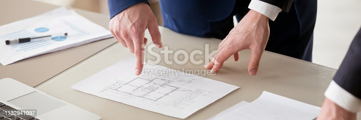 istock Horizontal photo businessman and architect discussing about construction investment 1132941037