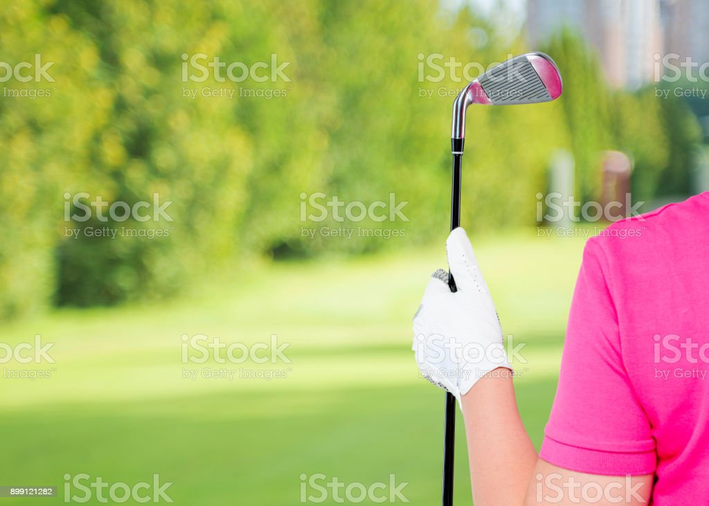 horizontal Photo gloved hand with a golf club and a space on the left stock photo