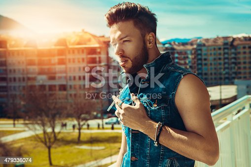 istock Horizontal photo of sexy male fashion model with cigarette 479336074