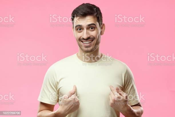 Horizontal photo of young positive european man in casual beige on picture id1022259700?b=1&k=6&m=1022259700&s=612x612&h=1yeinwsdcketojxdmfotmc2cutzlzmwjss cru9c2co=