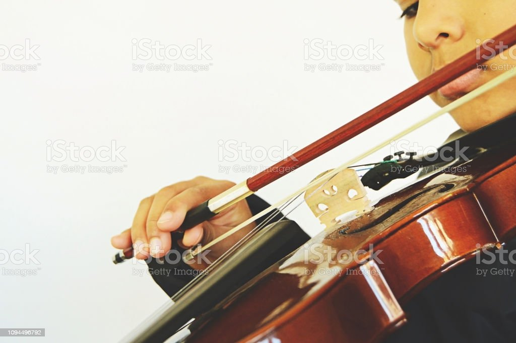 Horizontal Picture Of A Boy Playing The Stringed And Bowed