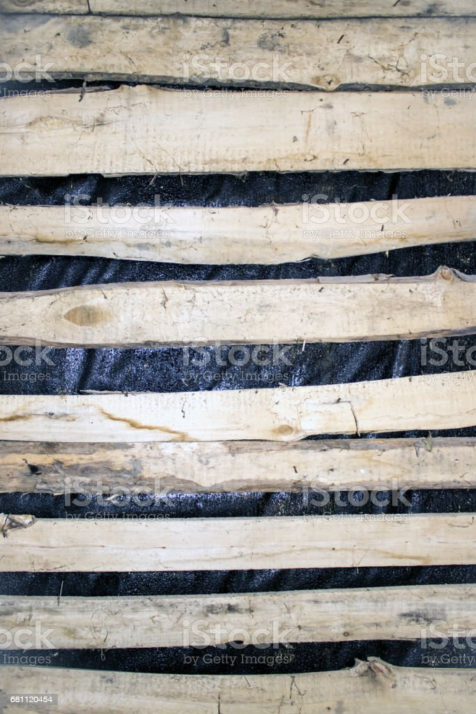 Horizontal planks on the roof under a roofing material royalty-free stock photo