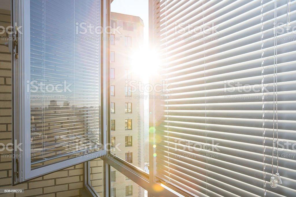 Horizontal plastic jalousie under sun rays stock photo