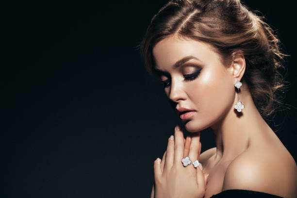 Horizontal portrait of a beautiful girl with shiny jewelry stock photo