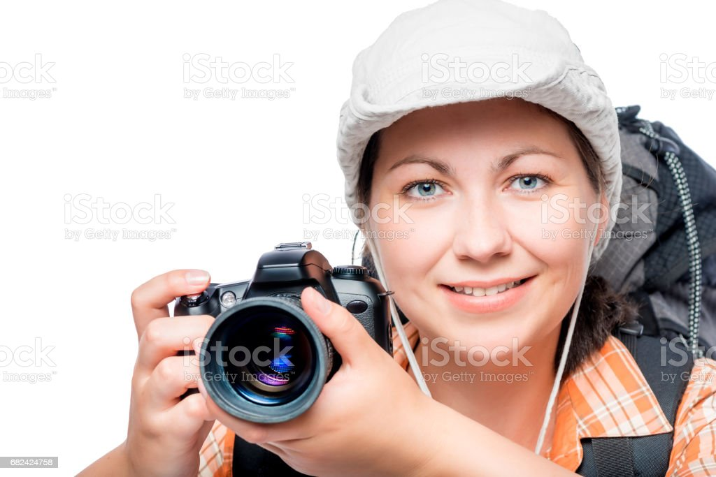 Horizontal portrait of a professional photographer tourist with a backpack isolated royalty-free stock photo