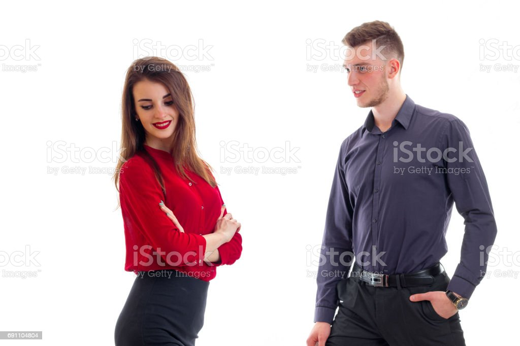 horizontal portrait of beautiful girl in red clothes and charming guy in shirt stock photo
