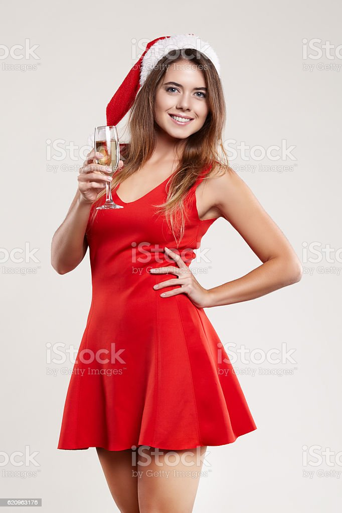 01c268401d093 Horizontal portrait of christmas girl with wineglass on white background -  Stock image .