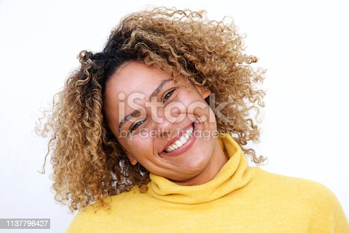 istock horizontal portrait of smiling african american woman against isolated white background 1137796427