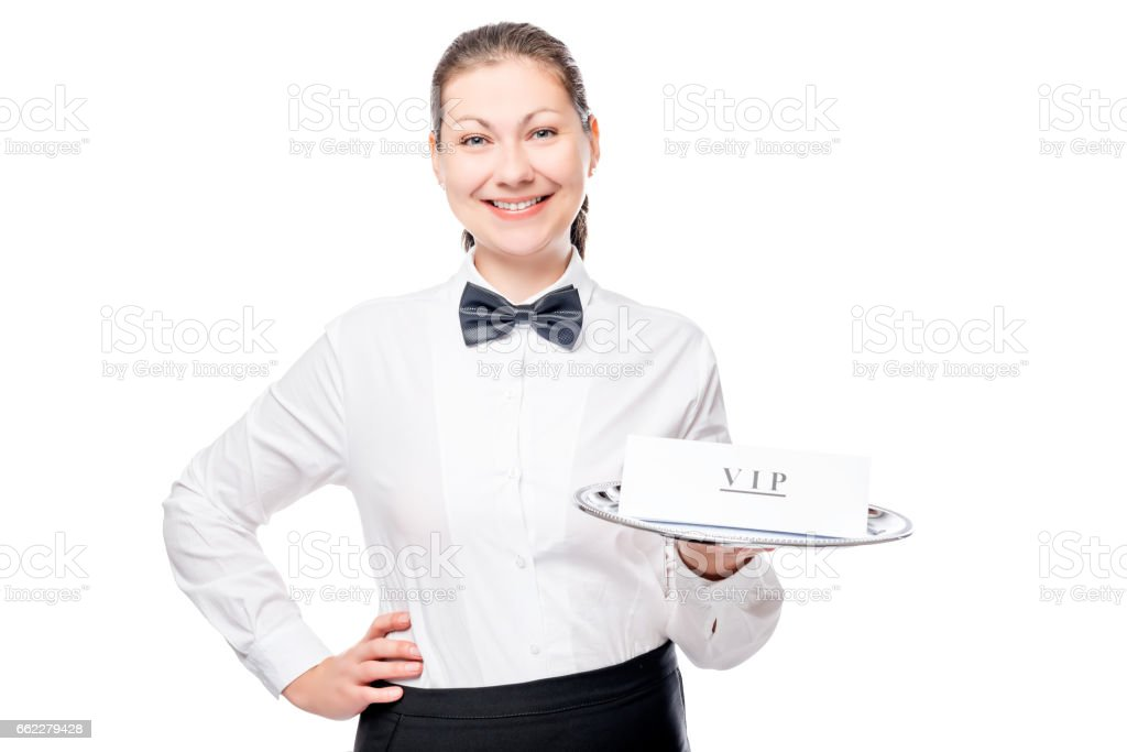 horizontal portrait of the girl waiter in a shirt and bow tie isolated stock photo