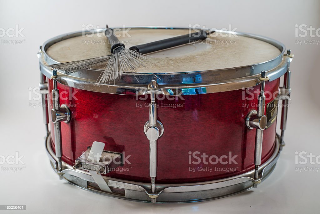 Horizontal Red Wooden snare drum and Jazz brushes isolated stock photo
