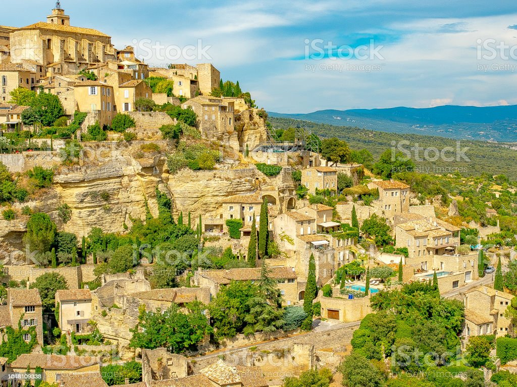 Horizontal scenic view of Gordes and countryside in Provence France stock photo