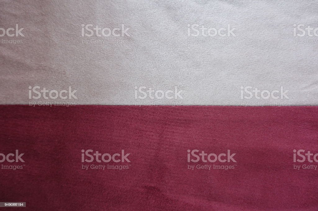 Horizontal seam between light pink and red artificial suede stock photo