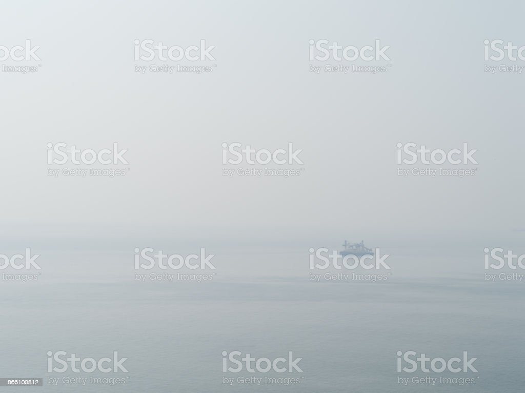 Horizontal sparse pale lonely ship in white ocean background bac stock photo