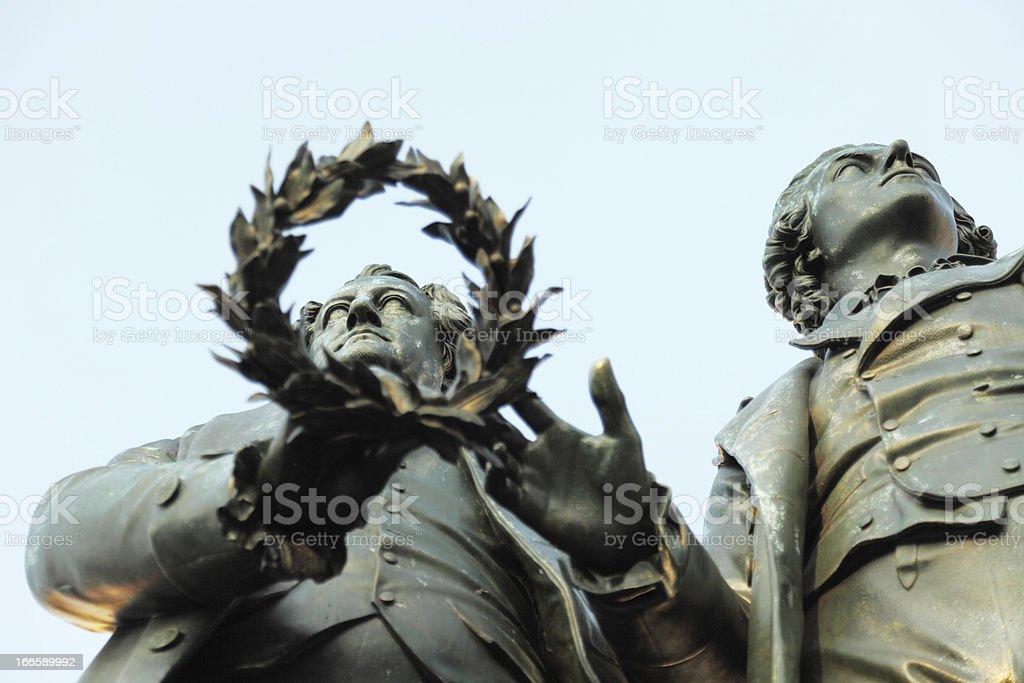 horizontal statue portrait of Goethe Schiller through laurel wreath stock photo
