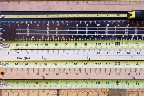 Horizontal stripes of tape measures stock photo