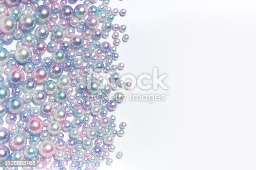 istock Horizontal texture of round pearl beads of different sizes 1126883168