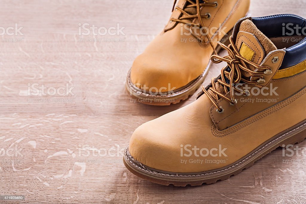 horizontal view very close up two working shoes On Wooden stock photo