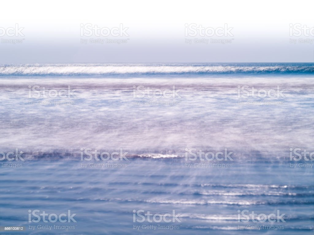 Horizontal vivid milk ocean horizon tidal waves background backd stock photo