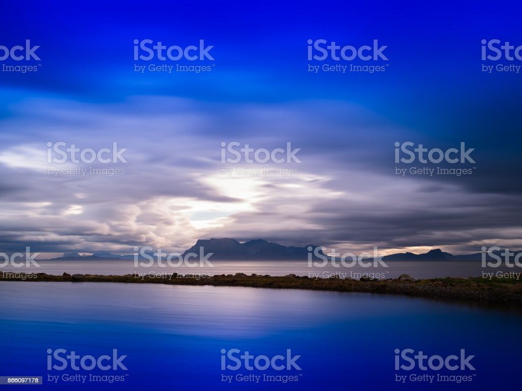 Horizontal vivid Norway dramatic ocean fjords mountains backgrou stock photo