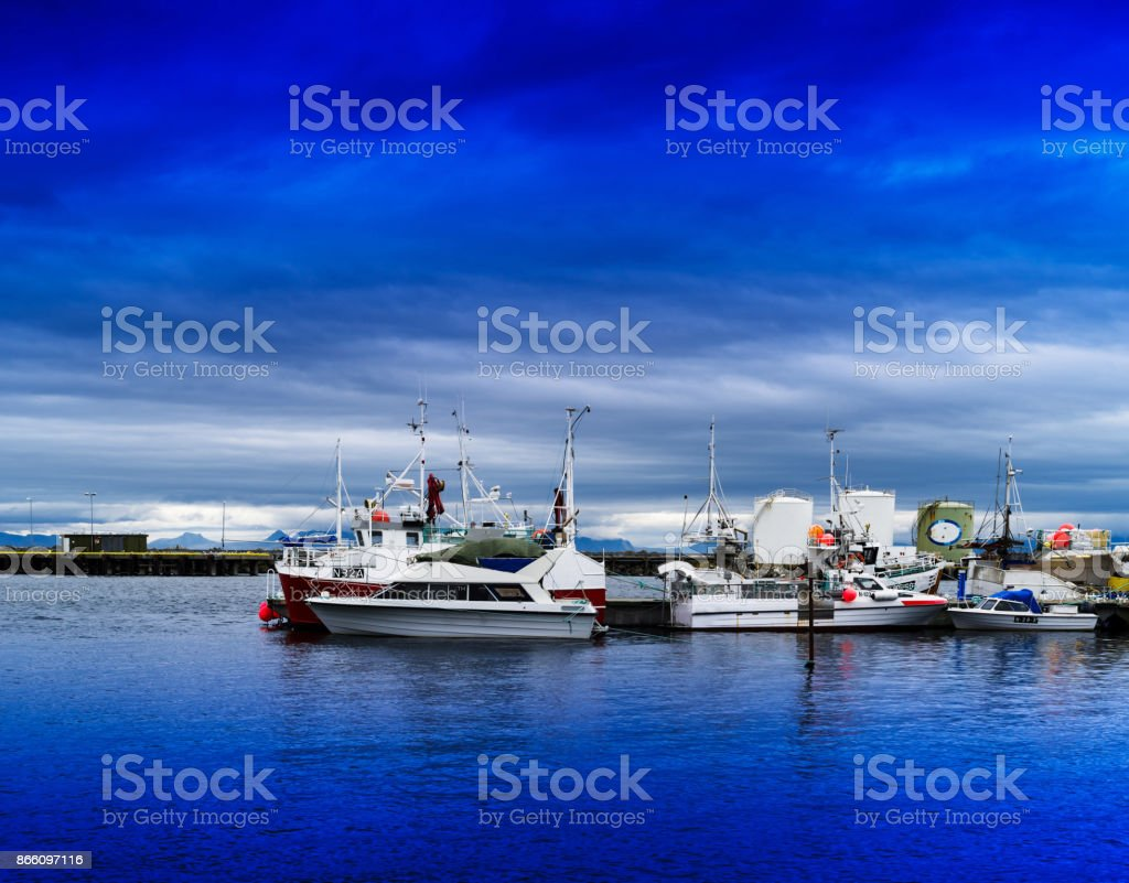 Horizontal vivid vibrant Norway ship quay landscape background b stock photo