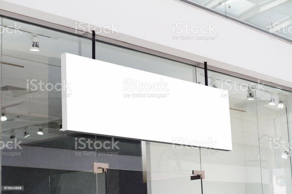 horizontal white signage on shop front stock photo