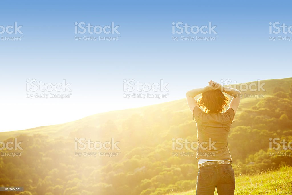 Horizontally framed shot of woman in rural setting royalty-free stock photo