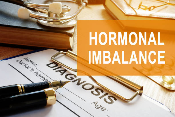 Hormonal imbalance concept. Medical documents on a desk. stock photo