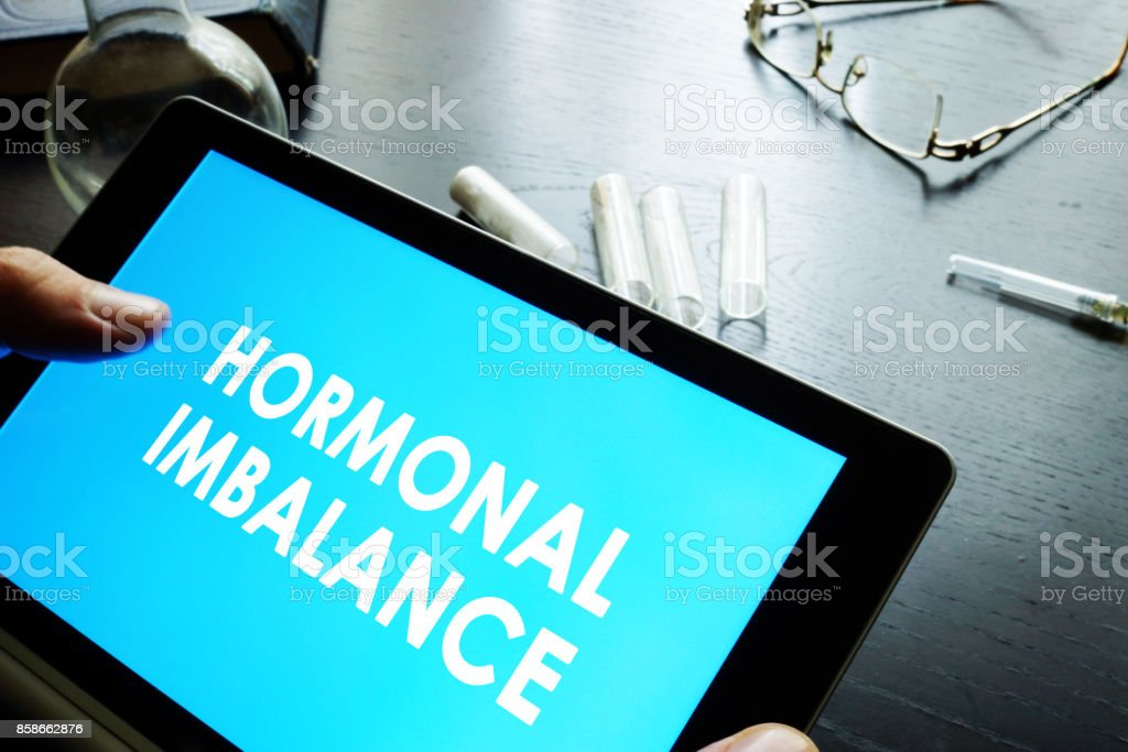 Hormonal imbalance sign on a tablet. stock photo