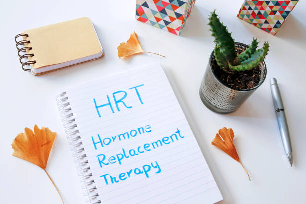 HRT Hormone Replacement Therapy written in notebook HRT Hormone Replacement Therapy written in notebook on white table replacement stock pictures, royalty-free photos & images