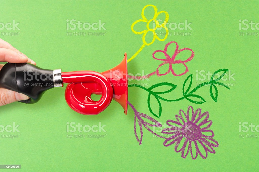 Horn or trumpet with hand drawn flowers emerging stock photo