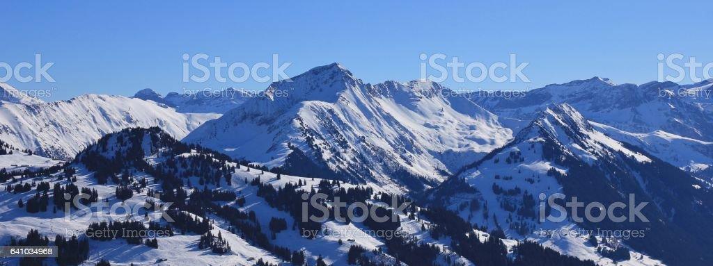 Hornberg, Giferspitz and Wasseregrat seen from the Rellerli ski area. stock photo