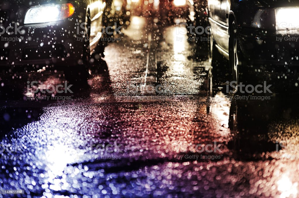 Horrible weather, snow and rain in the evening traffic stock photo