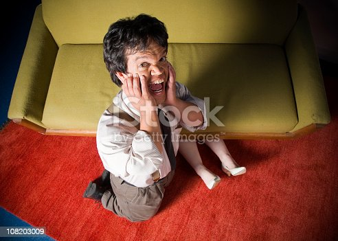 A little person horrified to find a body under his couch.  [url=search/lightbox/2476582] [img]http://richlegg.com/istock/banners/crime_scene_banner.jpg[/img][/url] [b][url=search/lightbox/2476582]Click HERE to see my other CRIME SCENE images[/url][/b]  [url=search/lightbox/4647079] [img]http://richlegg.com/istock/banners/diamondlypse_banner.jpg[/img][/url] [b][url=search/lightbox/4647079]Click HERE to see my other DIAMOND'LYPSE IMAGES[/url][/b]