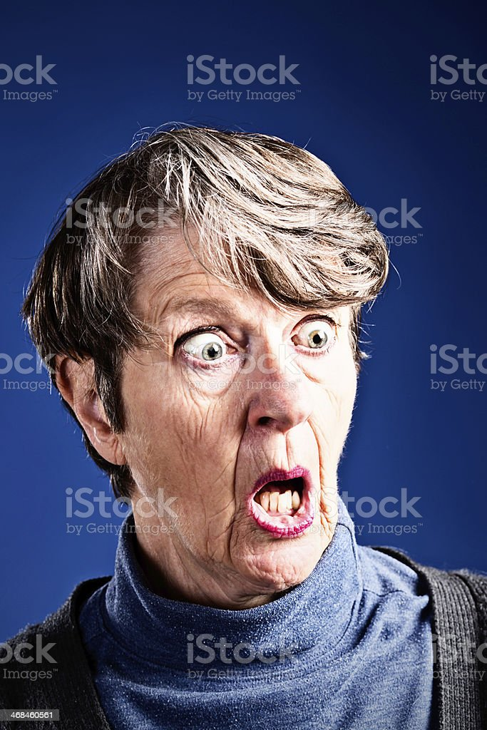 OMG! Horrified old woman gasps, wide eyed royalty-free stock photo
