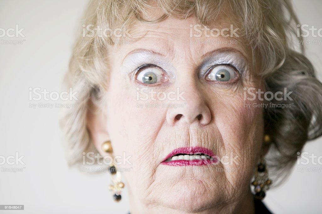 Horrified Senior Woman stock photo