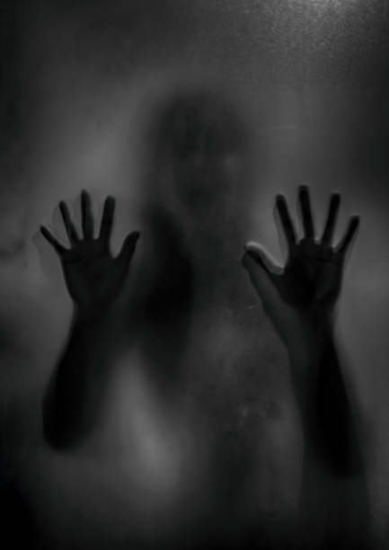 Horror ghost girl behind the matte glass in black and white halloween picture id1033261110?b=1&k=6&m=1033261110&s=612x612&w=0&h=aktuenb3oeg oikajvncx5slh6odnkjdob9 yitlzb4=