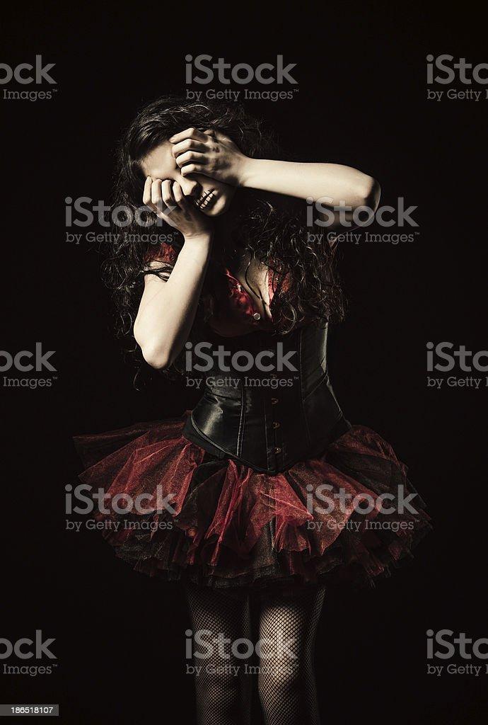 Horror shot: strange crying girl with mouth sewn shut royalty-free stock photo