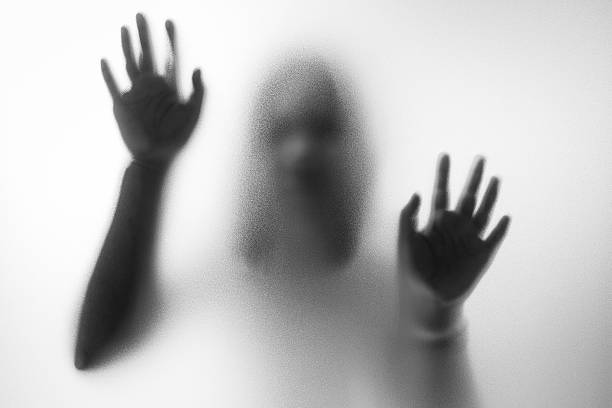 horror woman behind the matte glass - fear stock photos and pictures