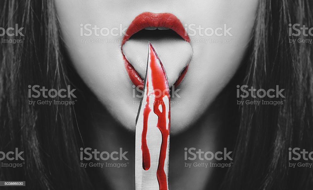 Horror woman with knife stock photo